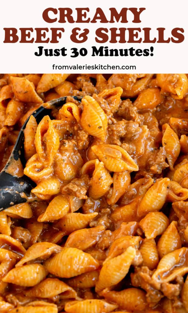 A closeup of a spoon scooping Creamy Beef with shell pasta with text overlay.