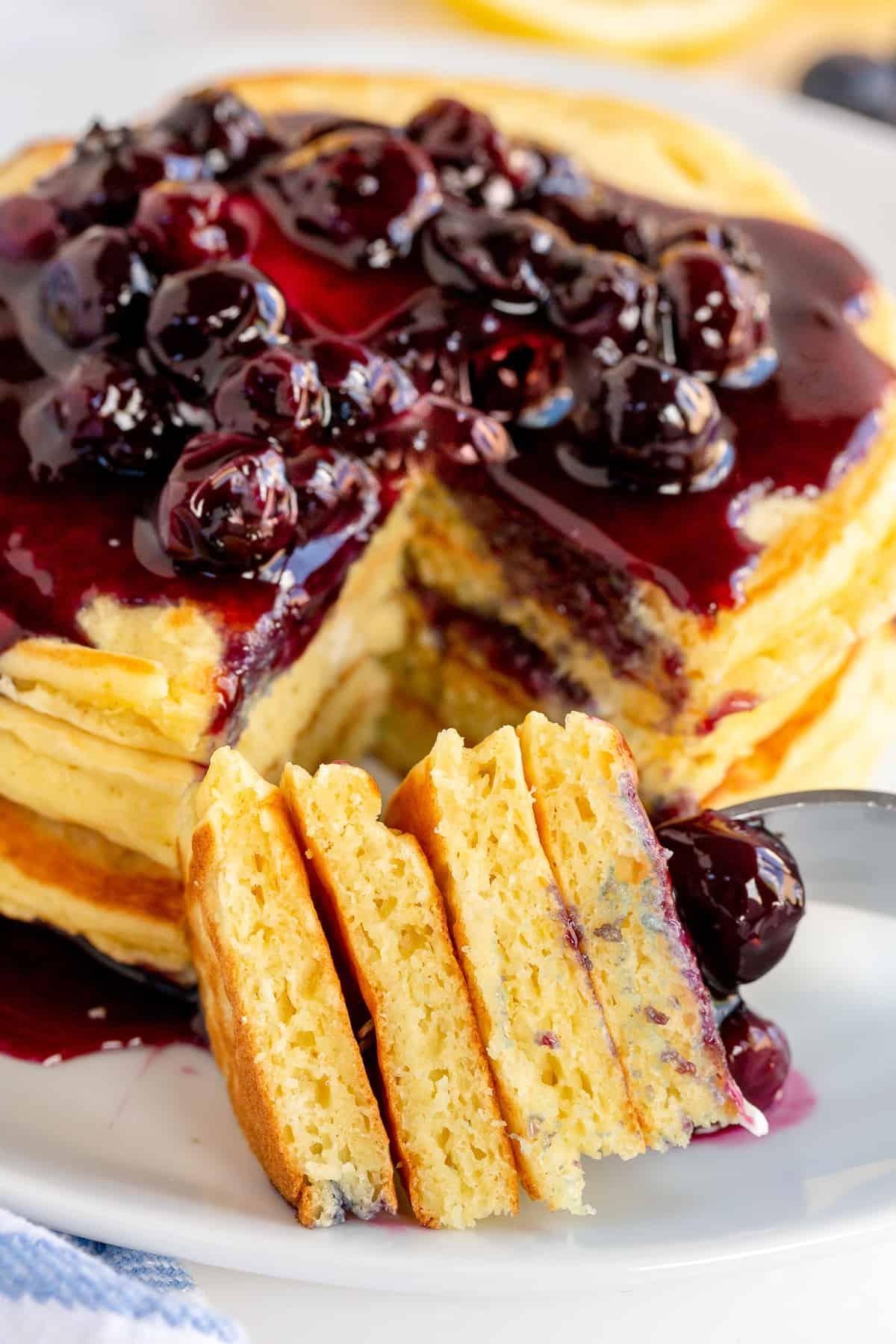 A close up of fork full of Lemon Ricotta Pancakes.