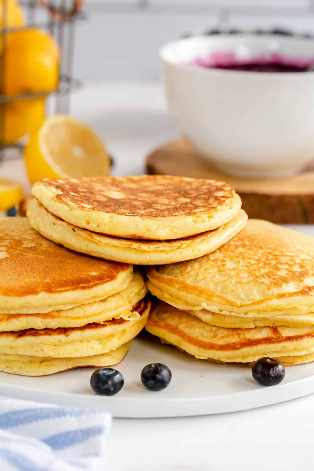 A close up of stacks of Lemon Ricotta Pancakes on a platter.