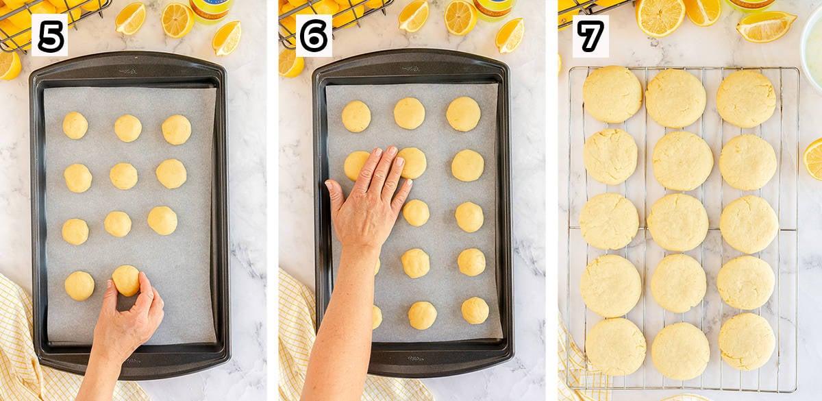 A hand flattens balls of cookie dough on a baking sheet.