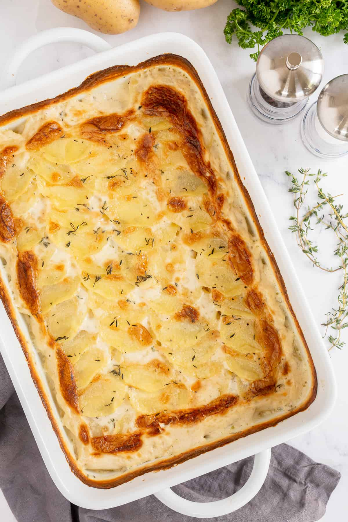 A baking dish full of scalloped potatoes shot from over the top.