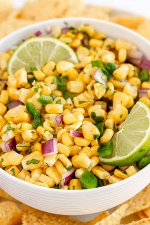 A closeup of a bowl of corn salsa.