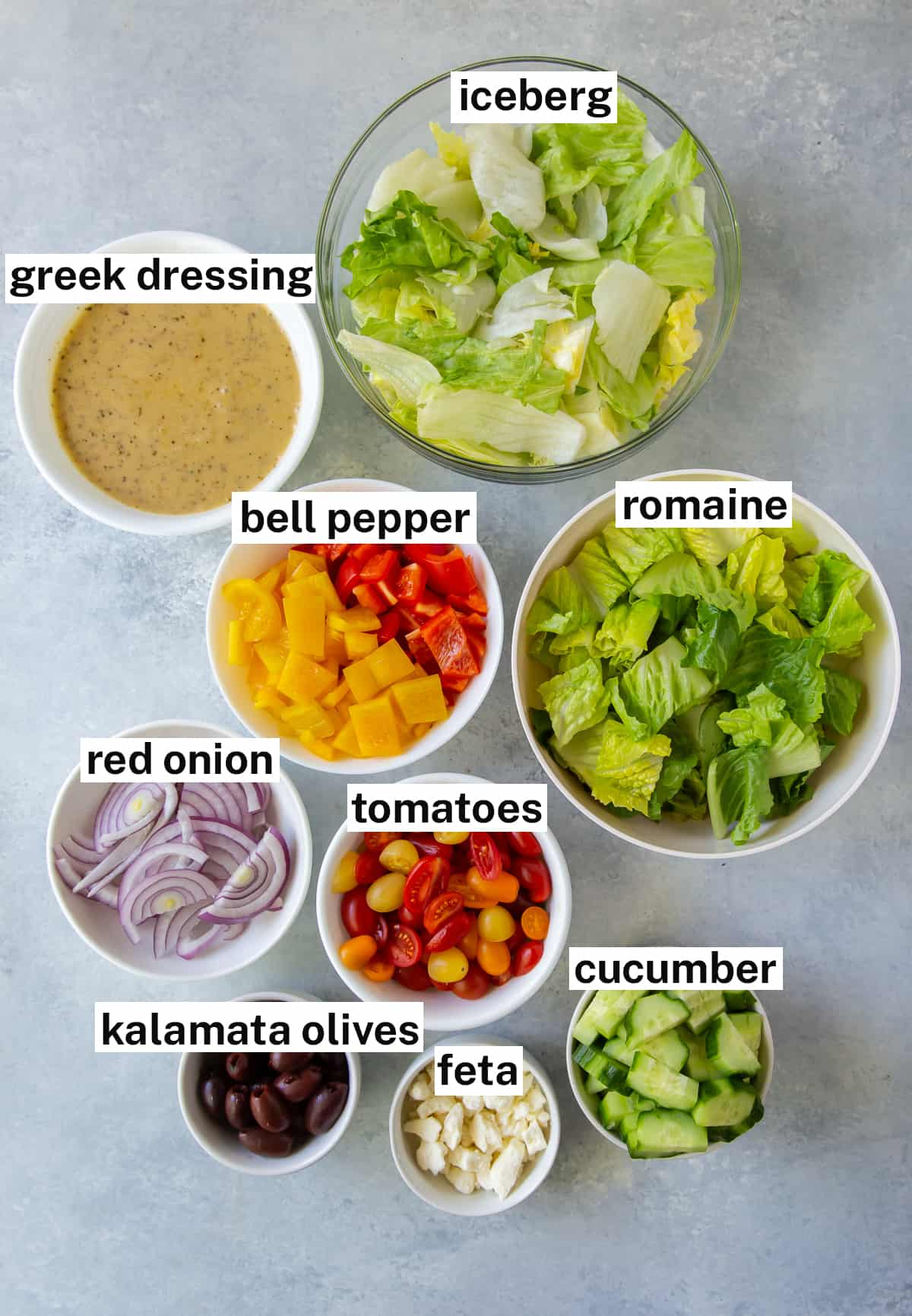 The ingredients to make Greek Salad with text overlay.