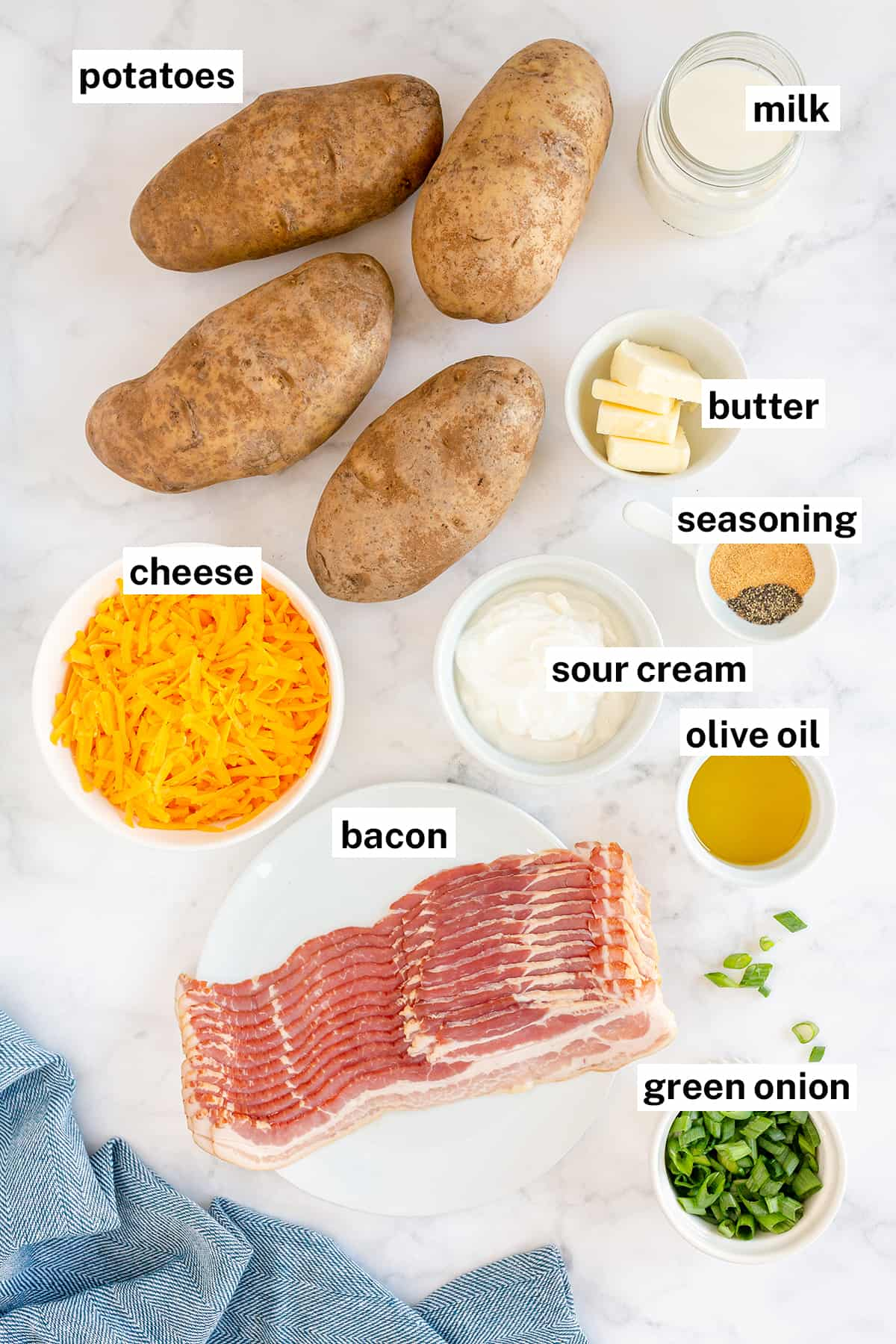 The ingredients to make Twice Baked Potatoes with text overlay.