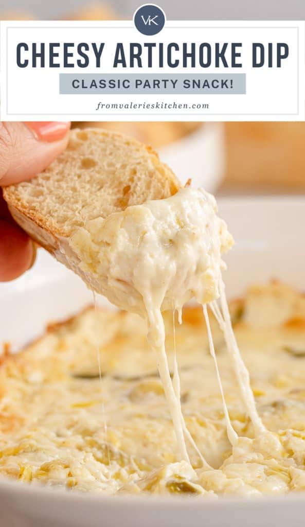 A hand dips a slice of bread into Artichoke Dip with text overlay.