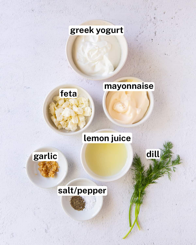 Ingredients including Greek yogurt, mayonnaise, feta and lemon juice with text overlay.