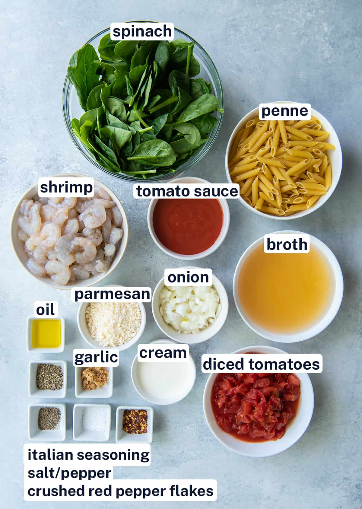 The ingredients for Shrimp and Spinach Pasta with overlay text.