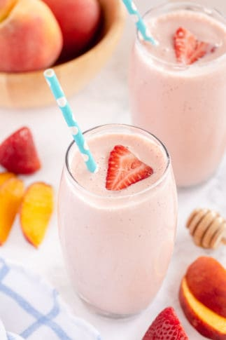 A top down shot of two Strawberry Peach Smoothies