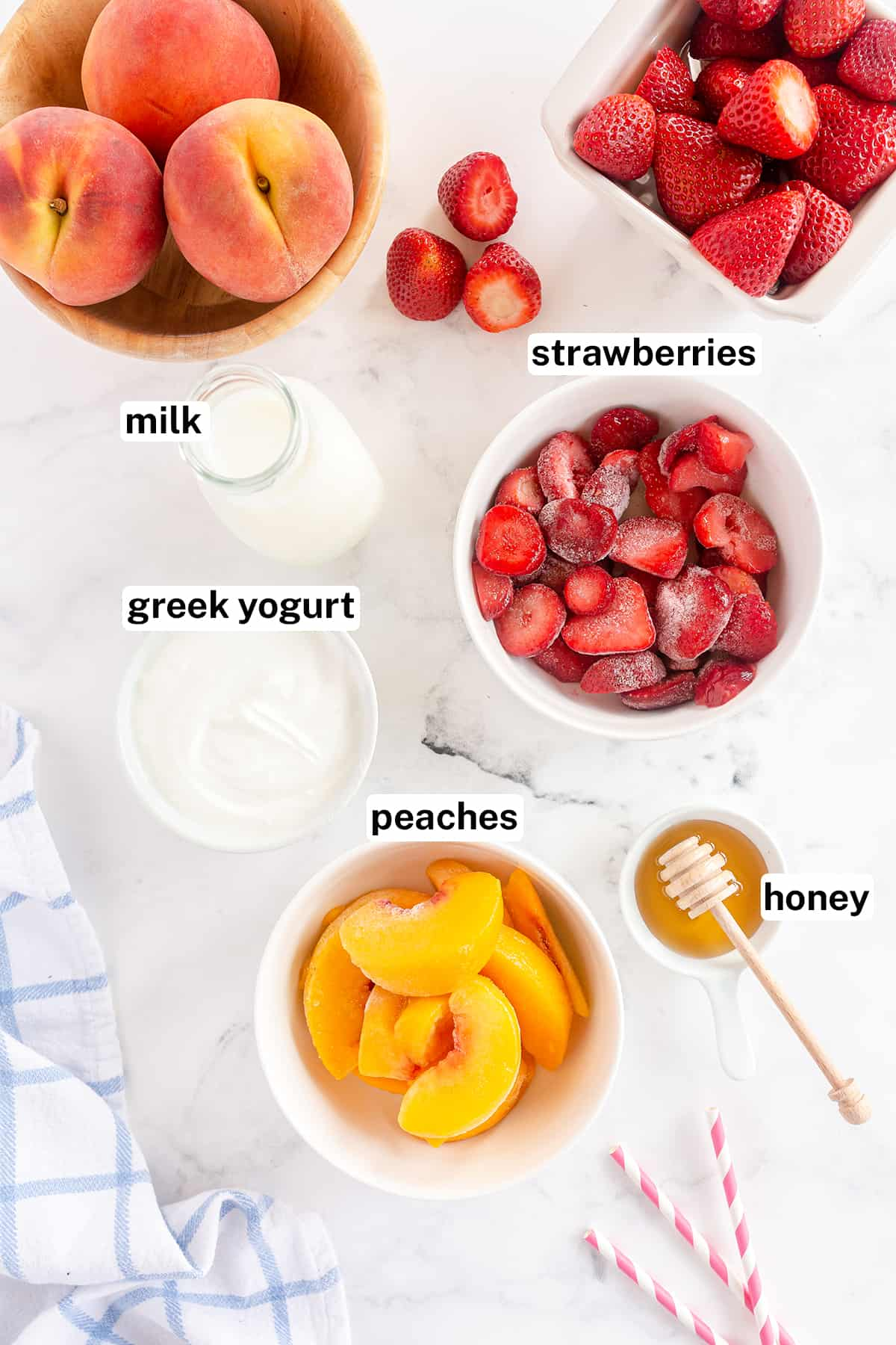 Ingredients for making strawberry and peach smoothies with text overlay.