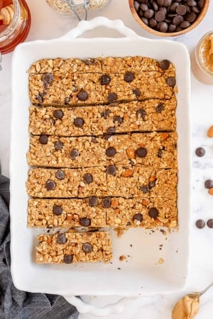 A dish full of granola bars with one missing.