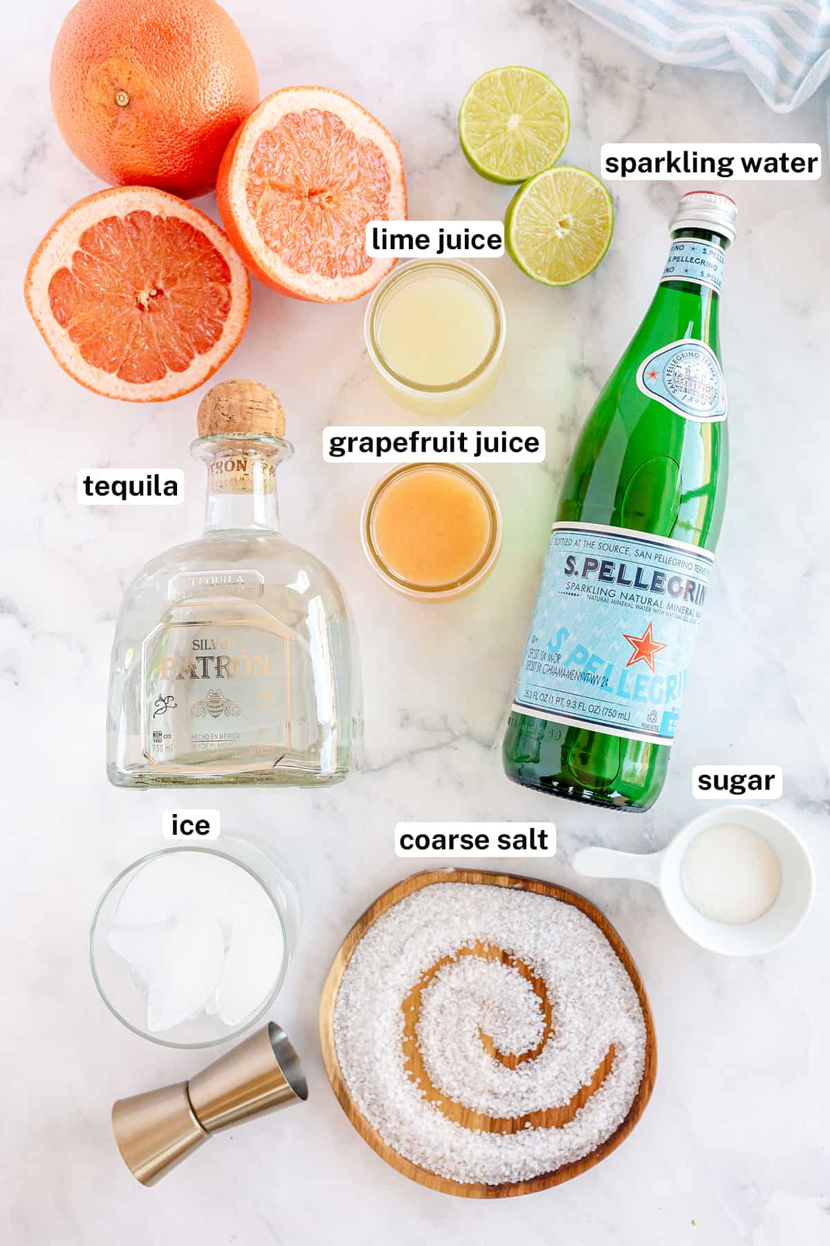 Tequila, Pellegrino and other ingredients to make a Paloma cocktail.