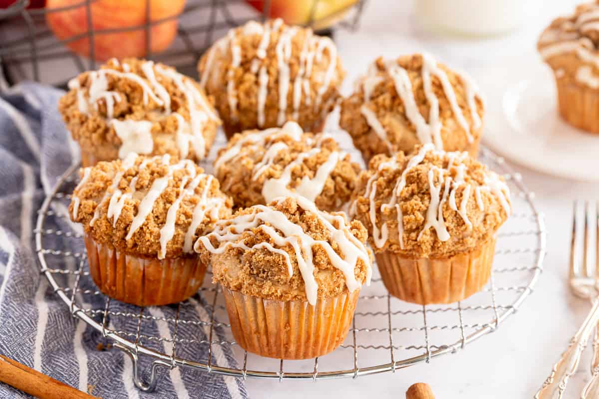 Glazed Apple Coffee Cake Muffins on a wire rack.