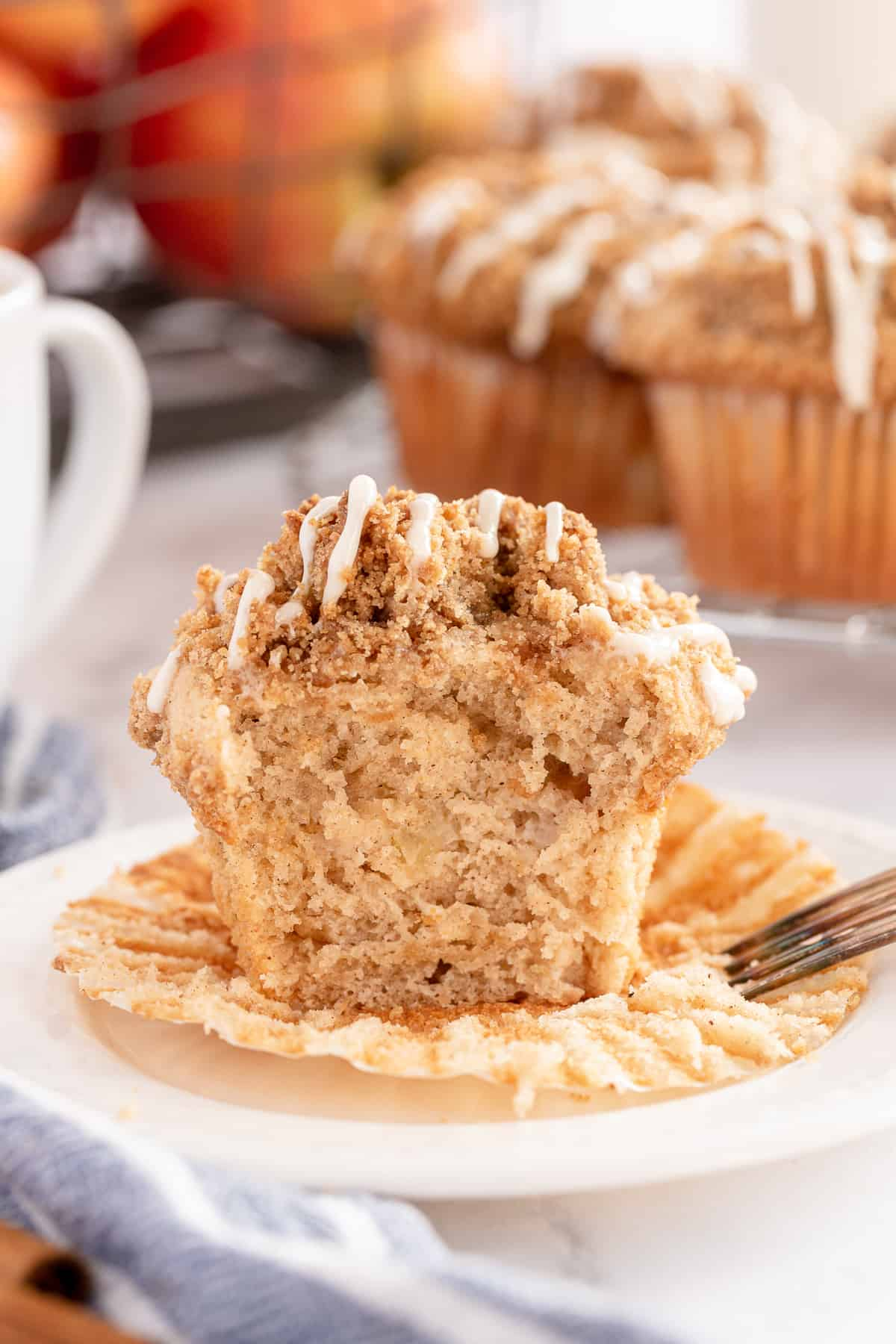An apple muffin that has been but open to reveal the inside.