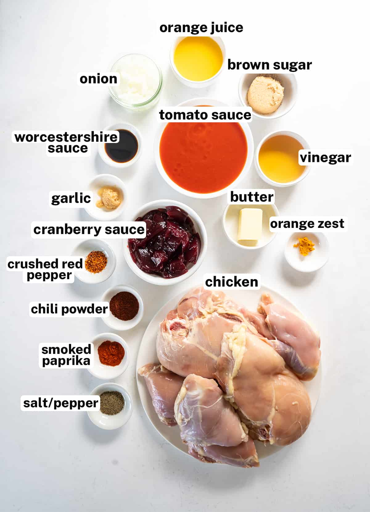 The ingredients to make Oven BBQ Chicken with overlay text.
